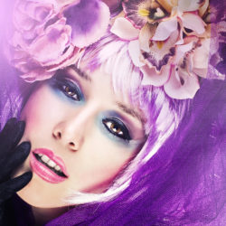 Fashion model with flowers and pink wig.Studio shot
